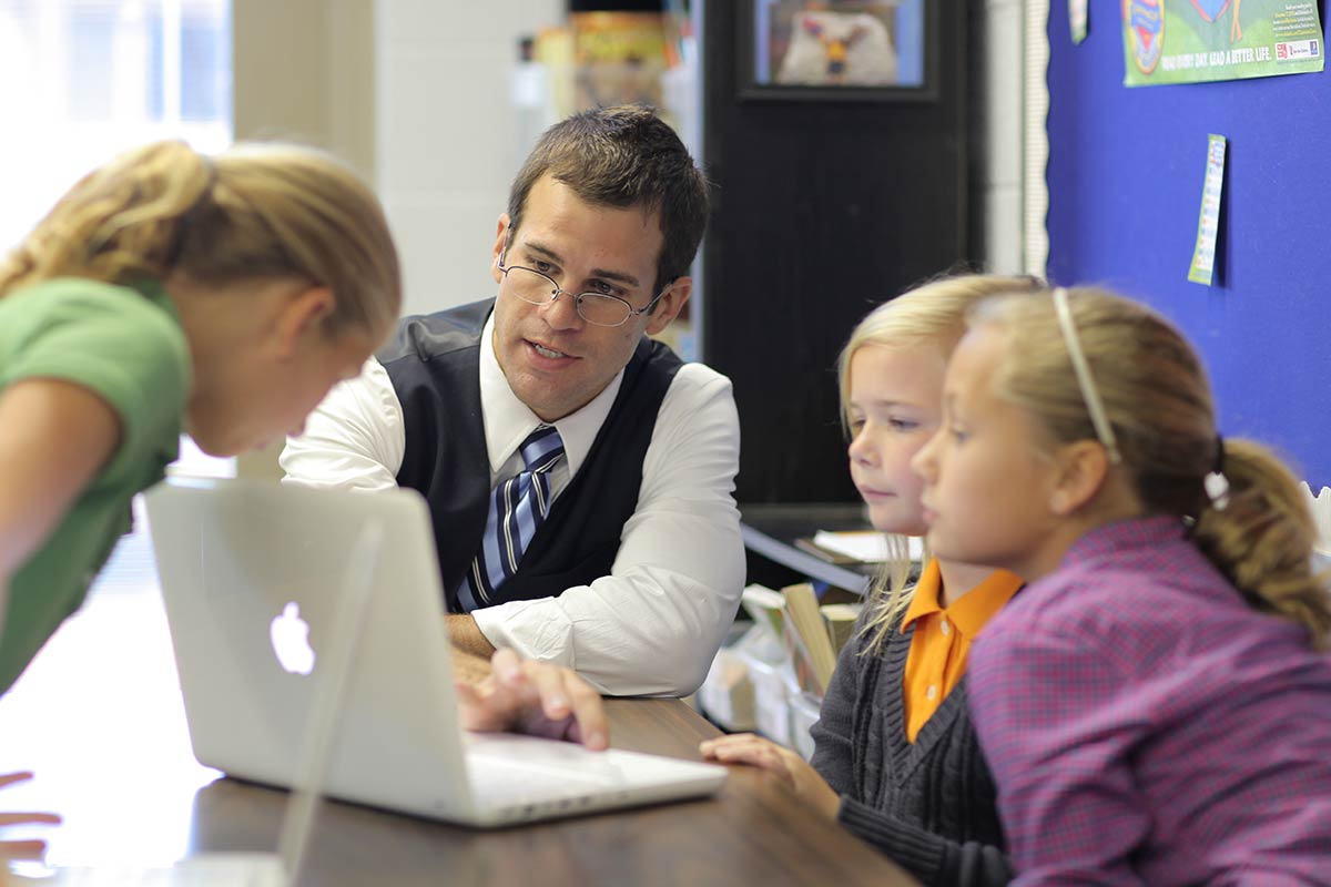 Knoxville teacher Jordan Haney with his Extreme Classroom Makeover winning students