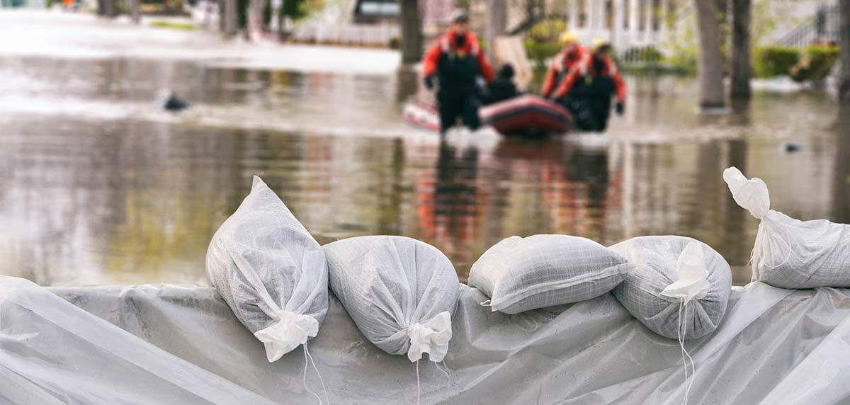 sand bags being used to hold back flood waters