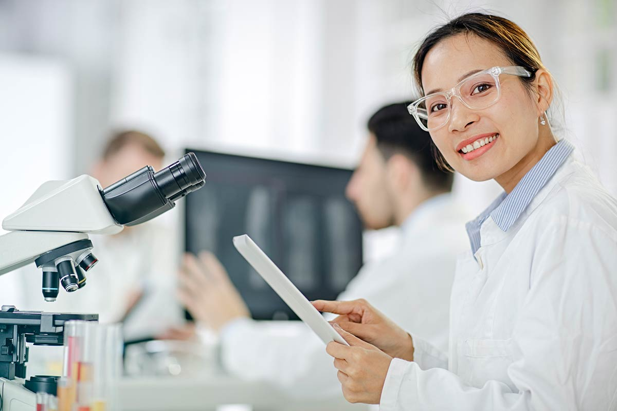 Young female scientist in laboratory